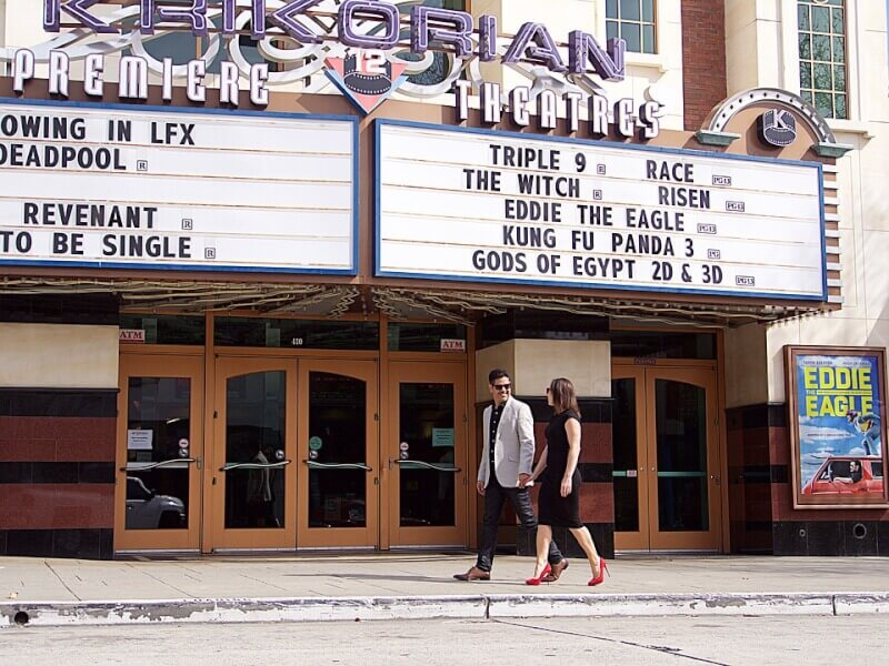 couple walking outside theater