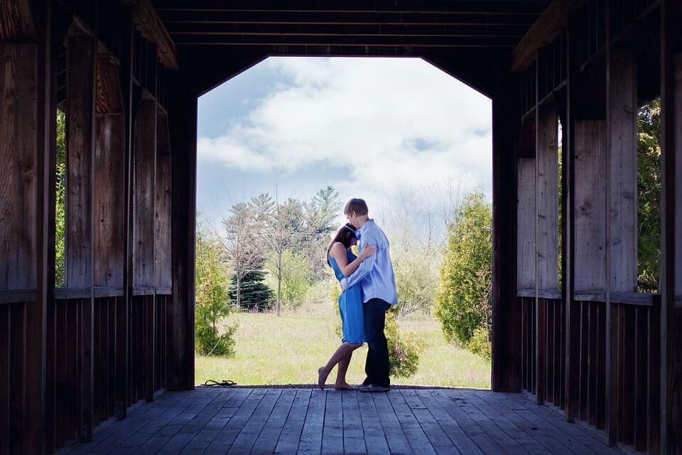 hugging in barn