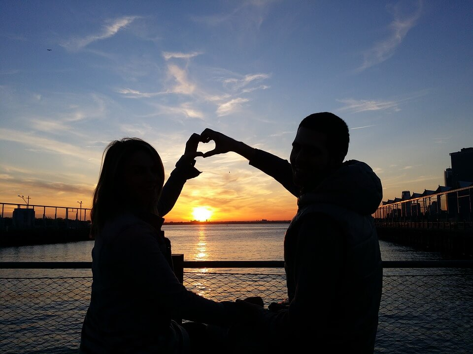 heart shape hands sunset