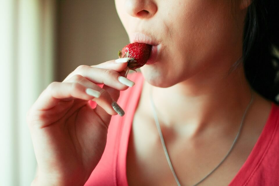 strawberry on lips