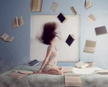 woman bed of books